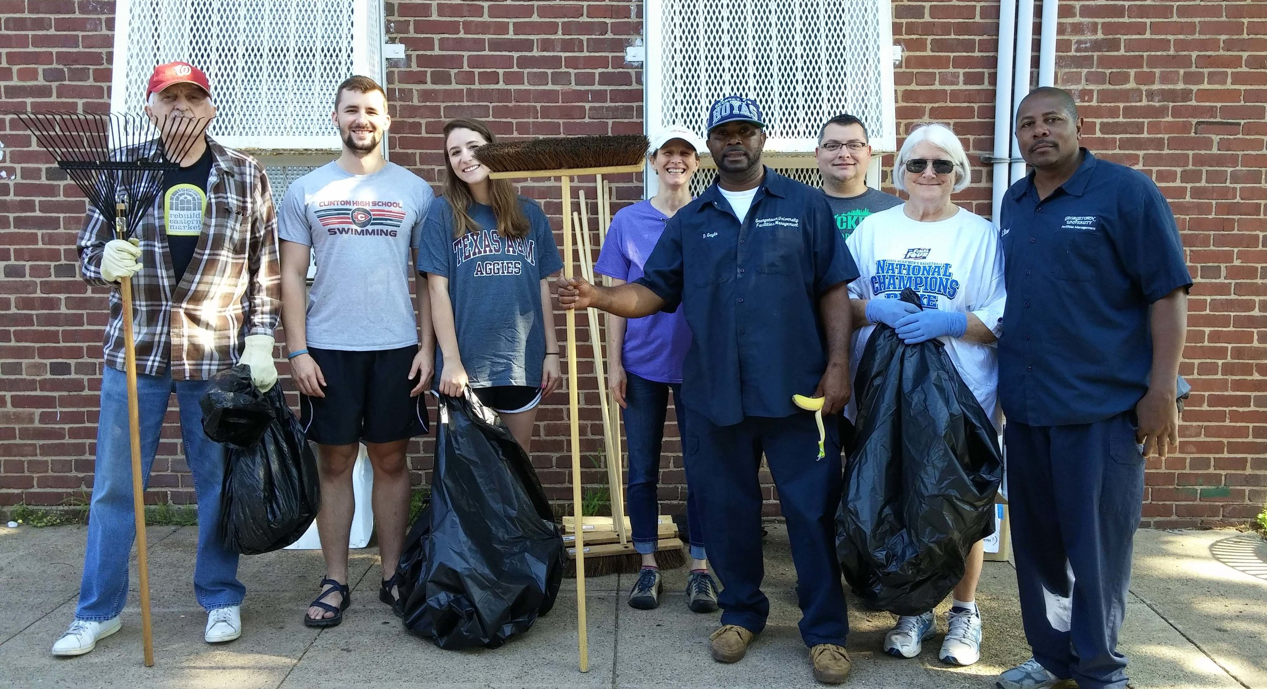Neighbors and GU staff report for duty at the spring 2017 clean-up.