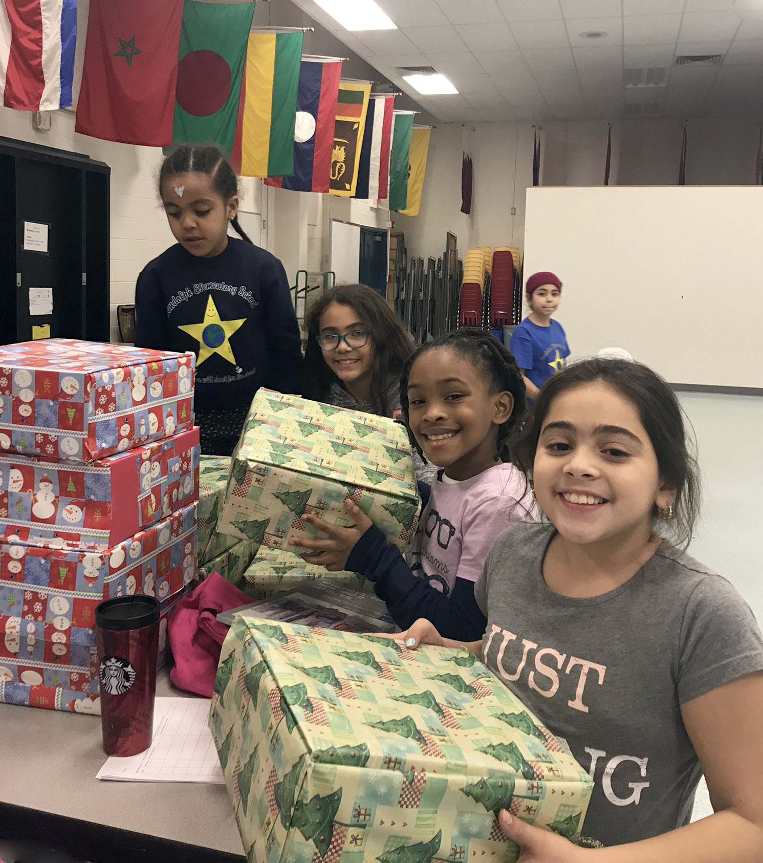 girl scout troop 6252 from Randolph Elementary School in Arlington assembled 11 boxes as one of the community service projects they voted to do this year to help their neighbors in need. photo by divya swamy.