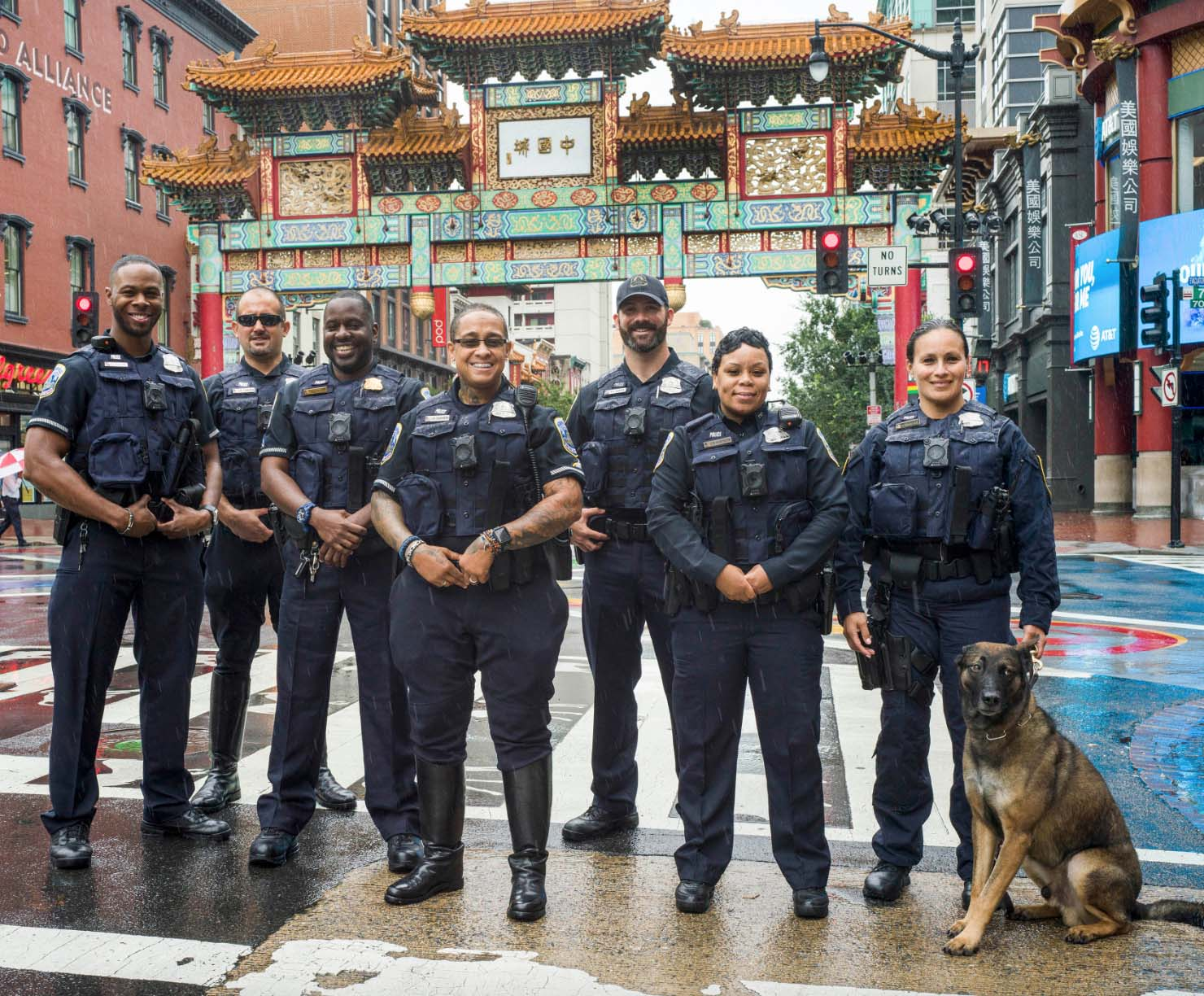 Officers from all seven MPD patrol districts pose in front of Chinatown's friendship archway. Photo courtesy MPD.