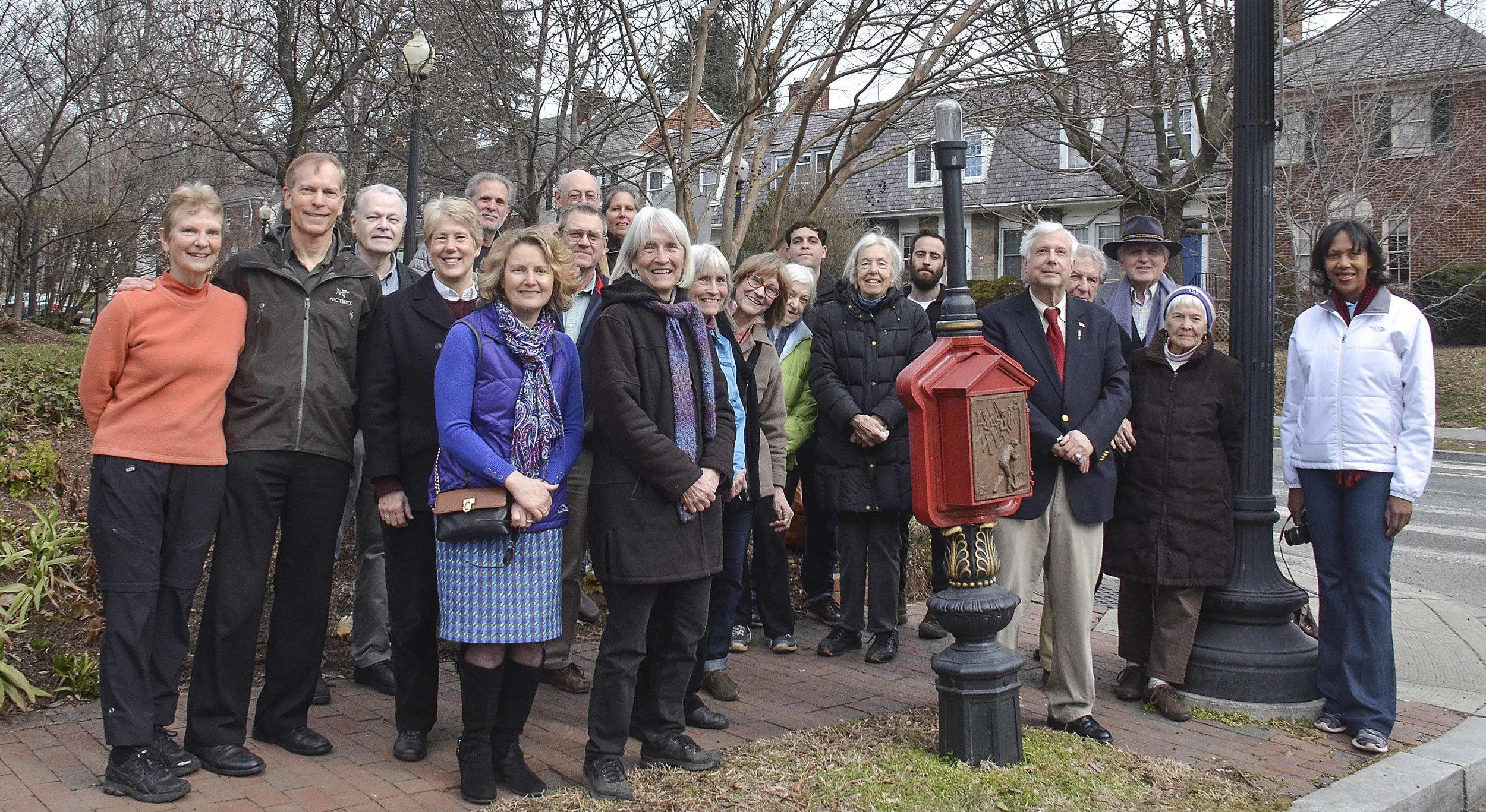 artist Jeanie Murphy (in coat and purple scarf) poses with the call box team and restoration funders at the 2016 Dedication of the Patriotism and Espionage call box. photo by linda brooks.
