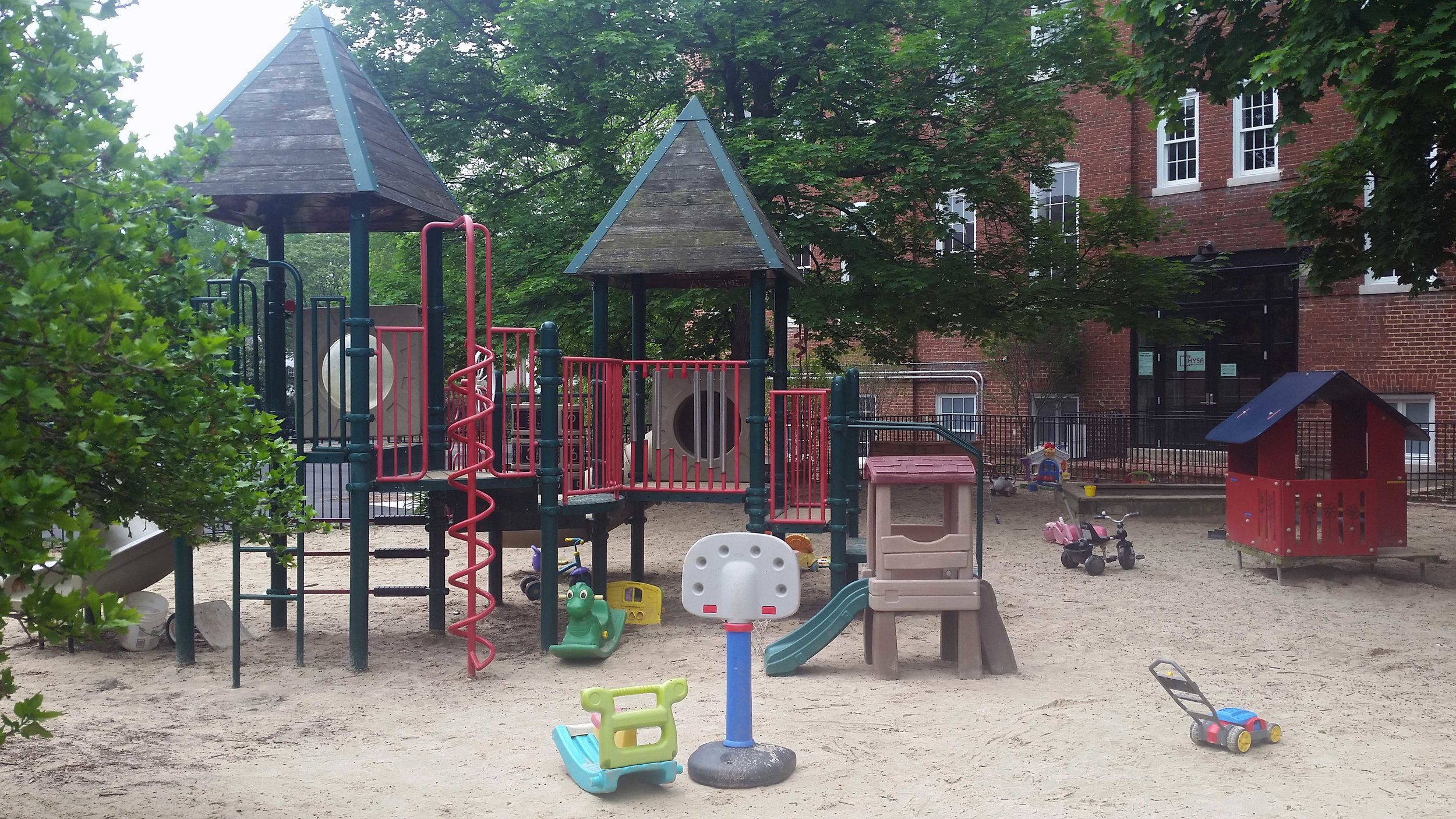 parents and minders can watch their kids from the tot lot's picnic benches.