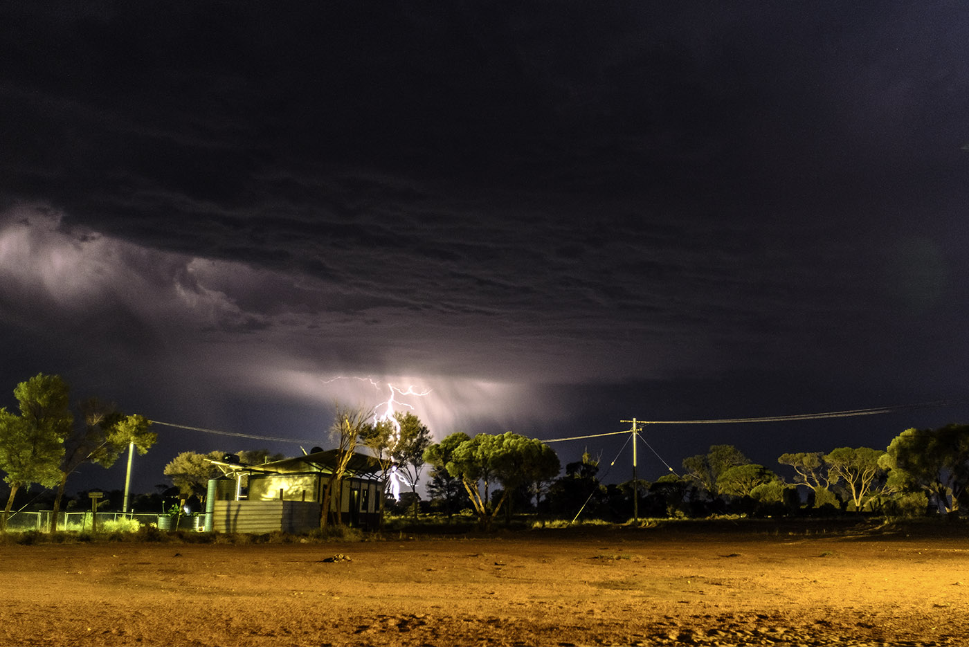 Our neighbour's house on a stormy night in the Western Desert. (c) Claudia Jocher 2016