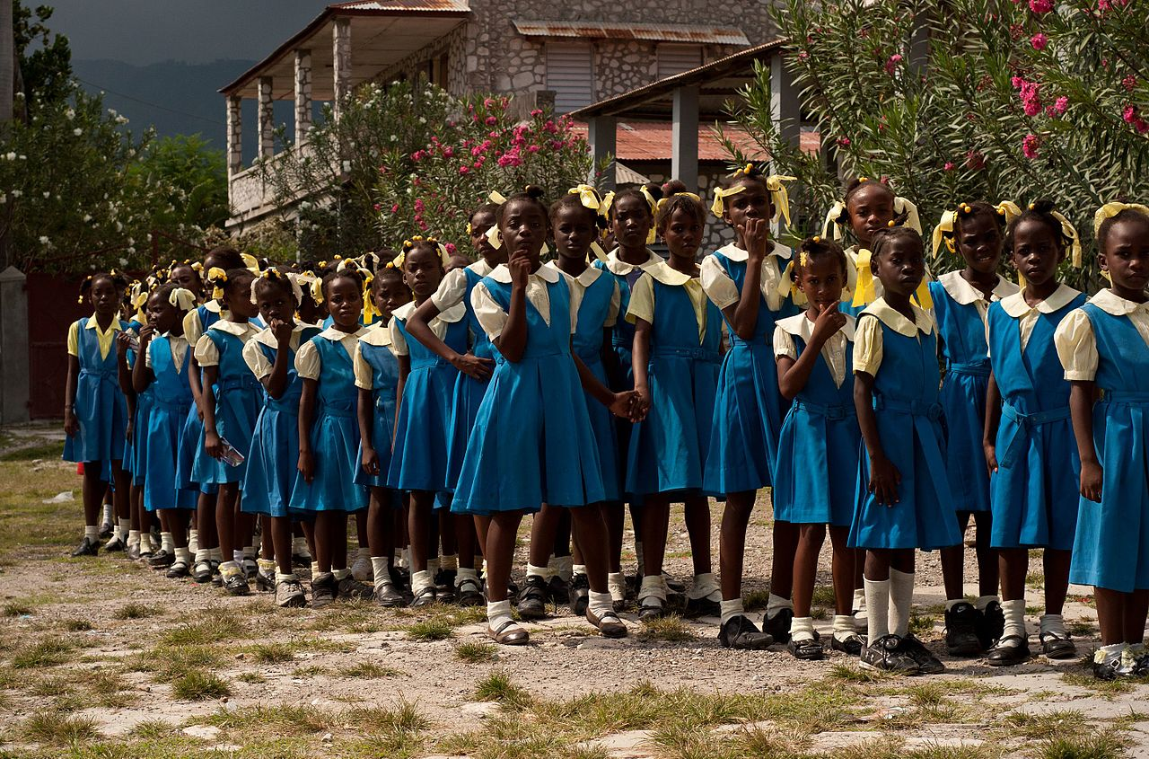 Haitian schoolgirls waiting to see the President in very clean uniforms. Pic by  Ben Edwards .
