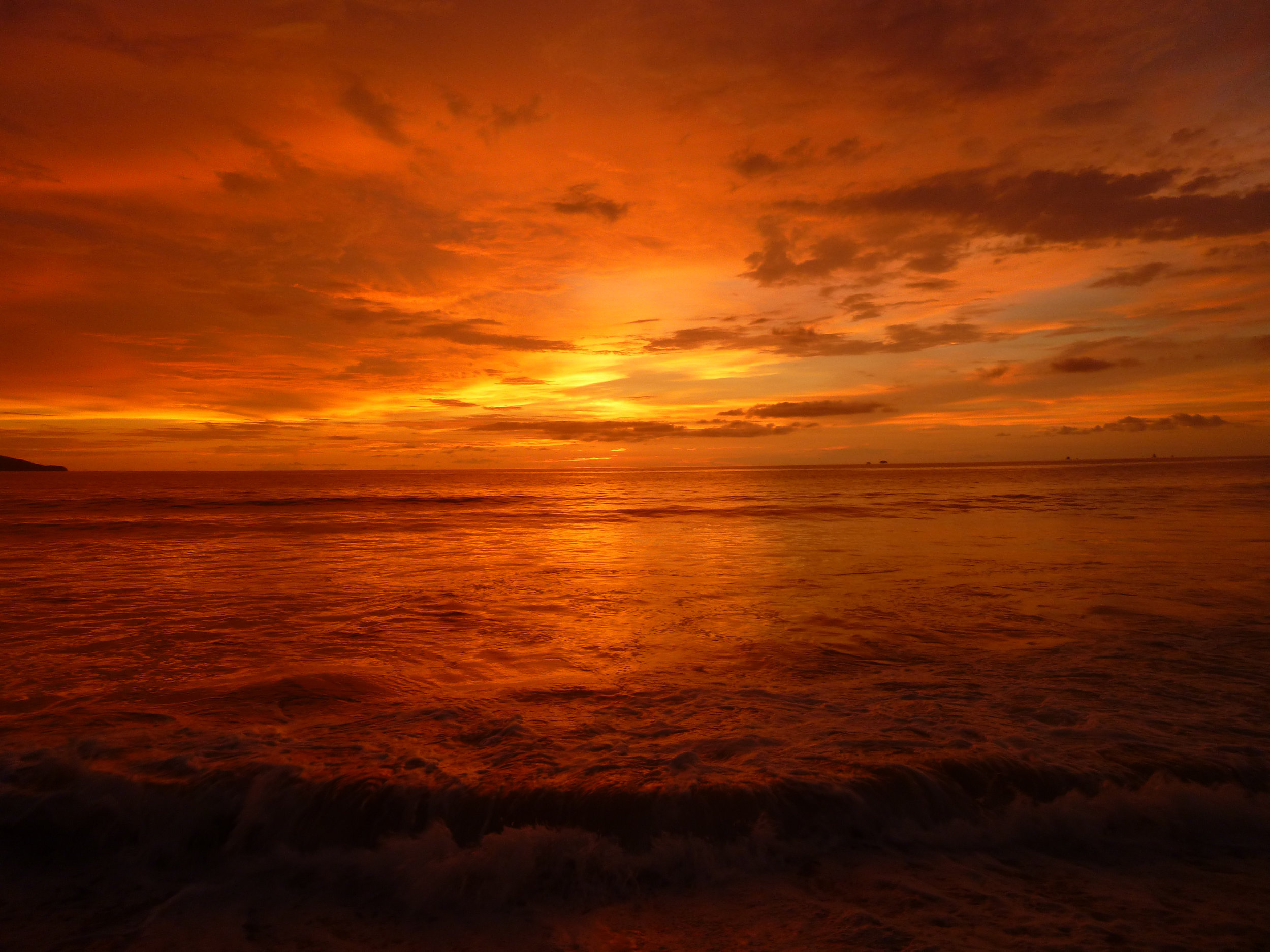 Firey sunset over the sea. No visible crocodiles. Photo by  Cindy del Valle .