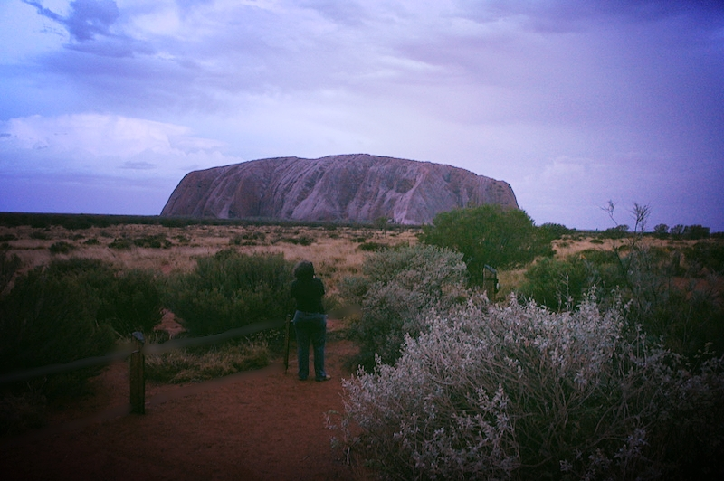 Claudia with tripod at Uluru in early evening. Pic by author.