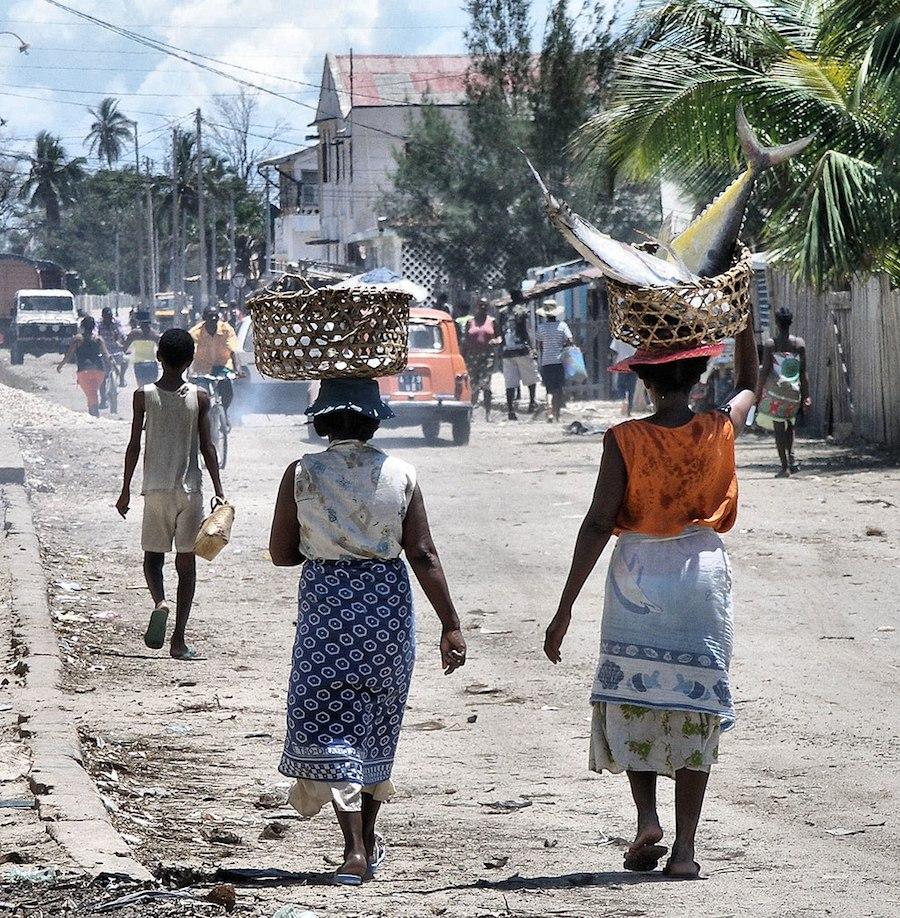Women taking yellow-finned tuna to market in Madagascar. Photo by  Bluwoad .