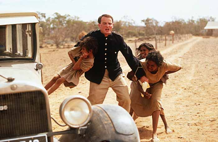 Aboriginal children snatched from their mother. Still from the movie  Rabbit Proof Fence .