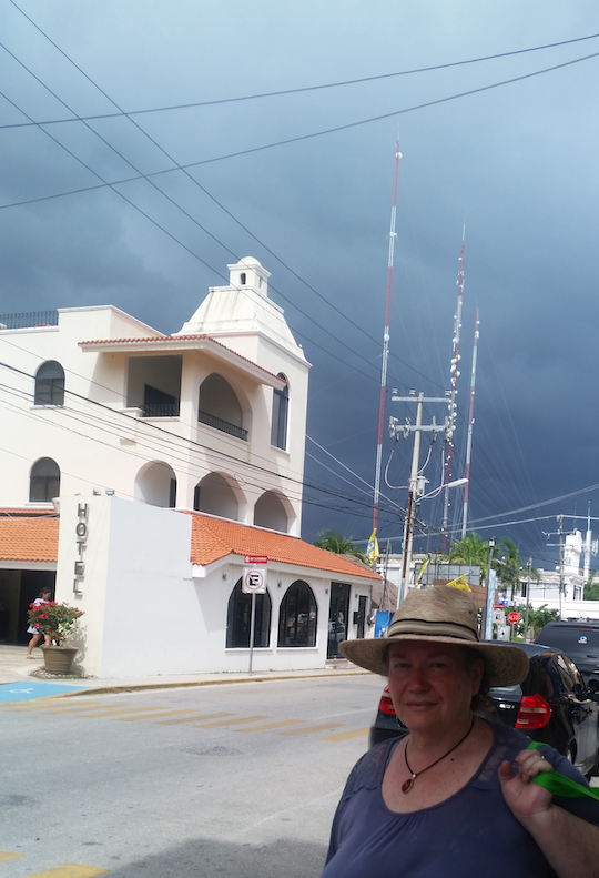 Storm brewing in Quintana Roo. The author on the way home from the shops. Photo by Claudia Jocher.