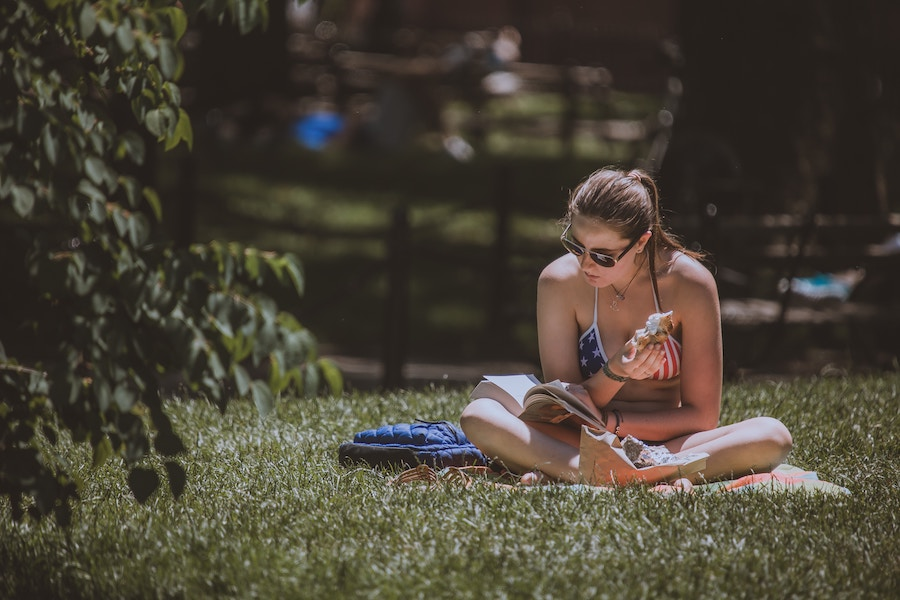 Time to be transported, a book in the sun. Photo by  Ali Morshedlou .
