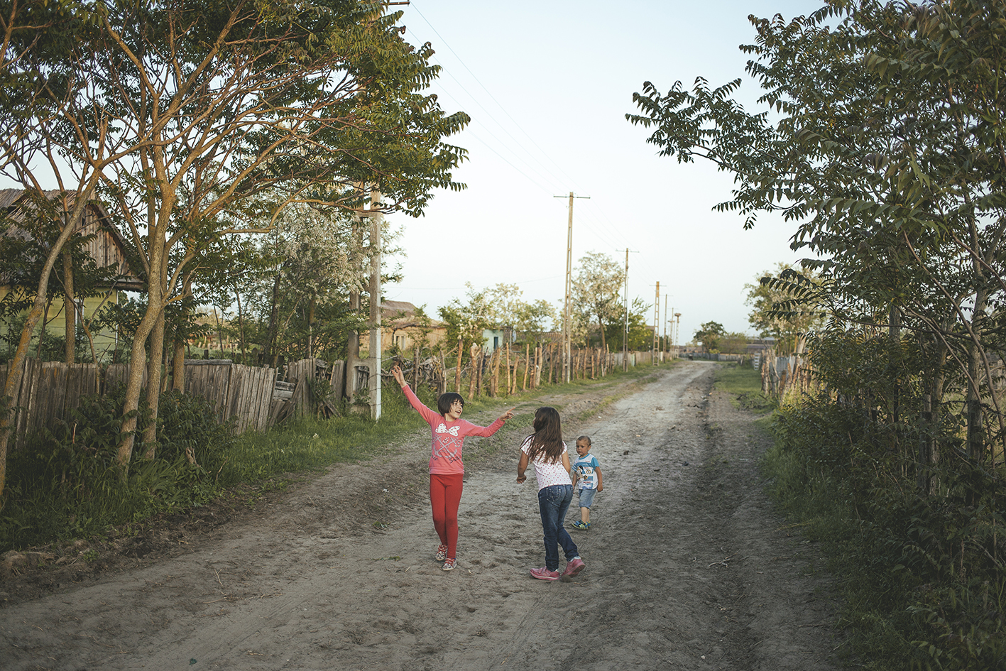 Children playing on the street, Letea, Romania, 2015