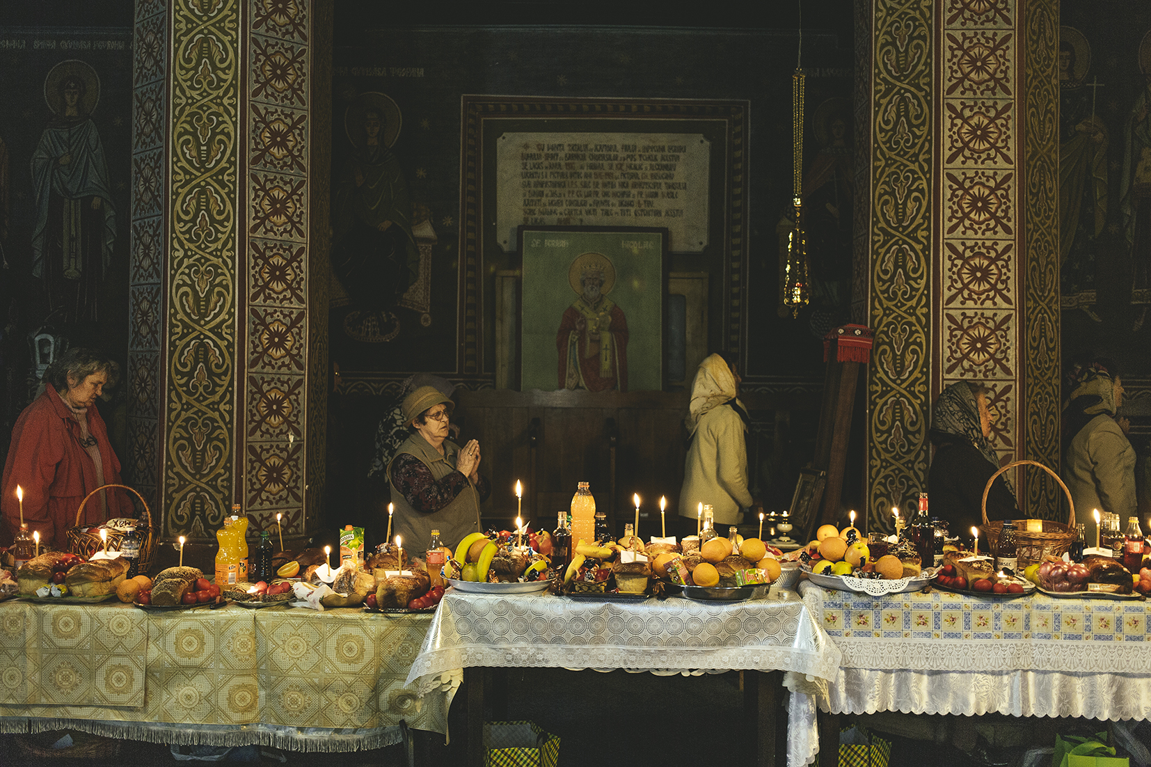 Food is blessed in the orthodox church, the day of Saints Constantine and Helena, Sulina, Romania, 2015
