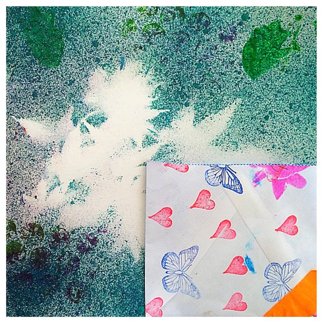 Student work: Spray ink stenciling and secret stamp pocket inspired by Nature.