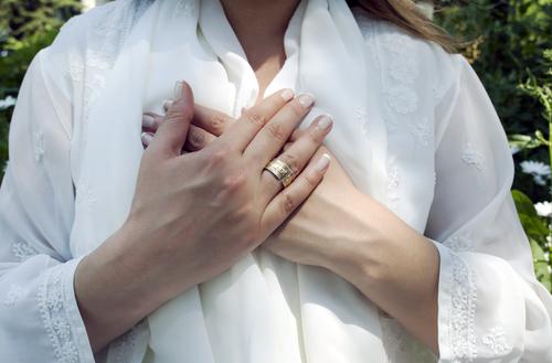 White Shirt Woman Hands Over Heart.jpg