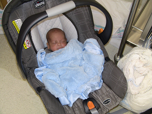 NICU baby going home in blue blanket
