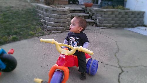 NICU grad at home riding bike
