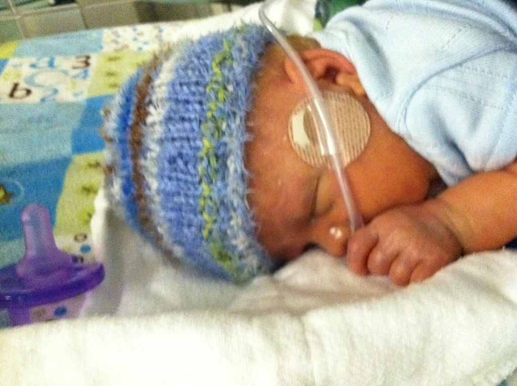 Premmie baby with oxygen cannula, sleeping