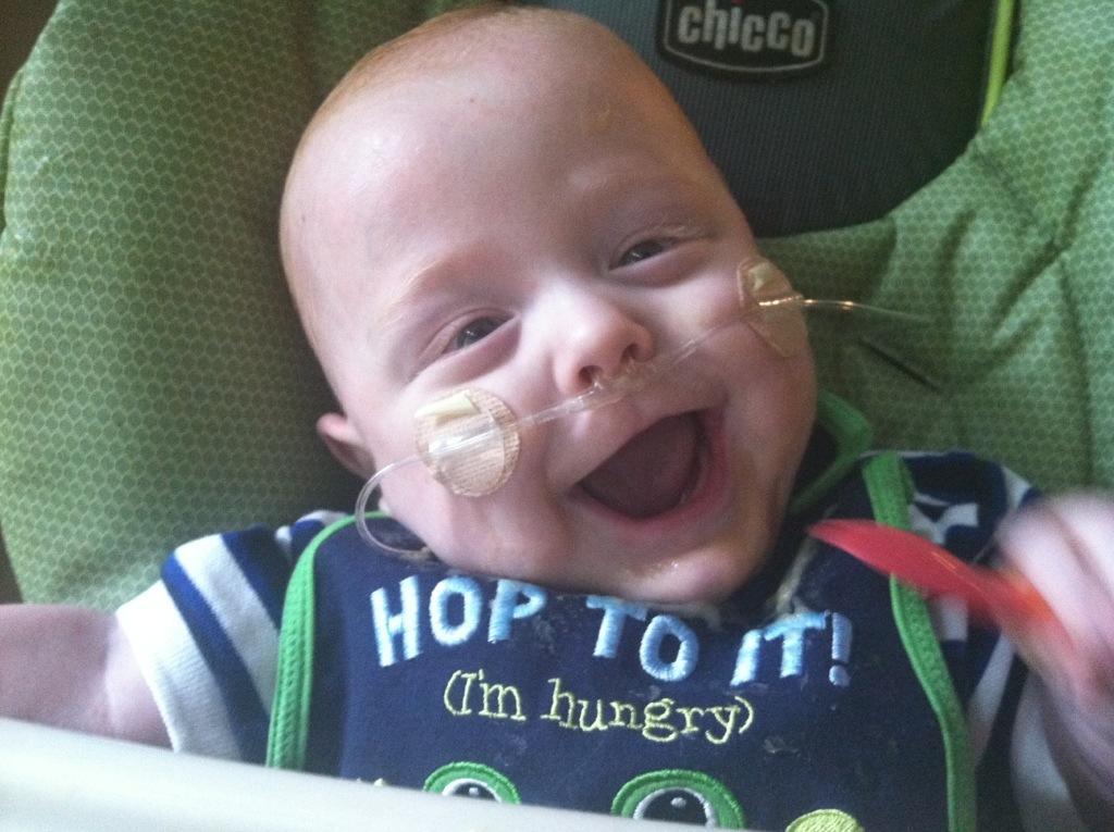 Smiling preemie with oxygen