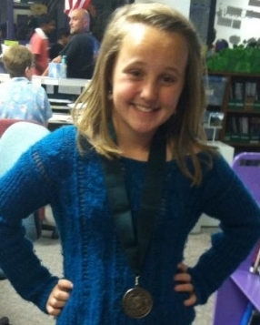 former 35 weeker Taylor is now a girl scout