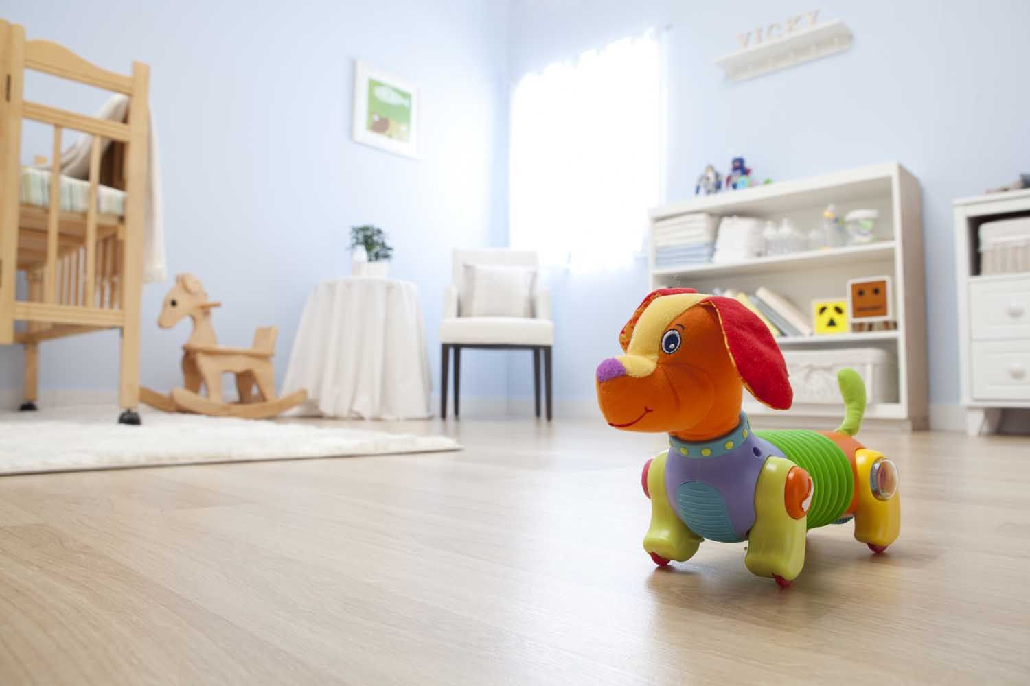 newborn baby home nursery with play toy