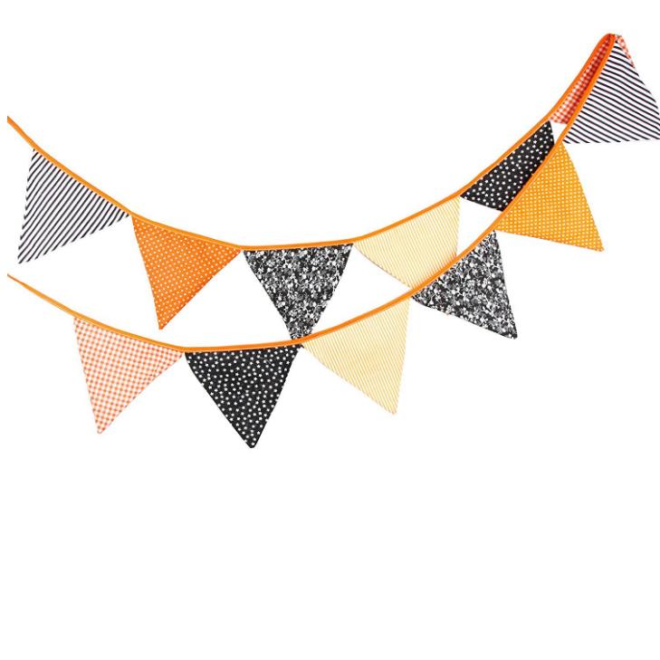 use halloween-themed bunting to drape on the crib for NICU halloween decor