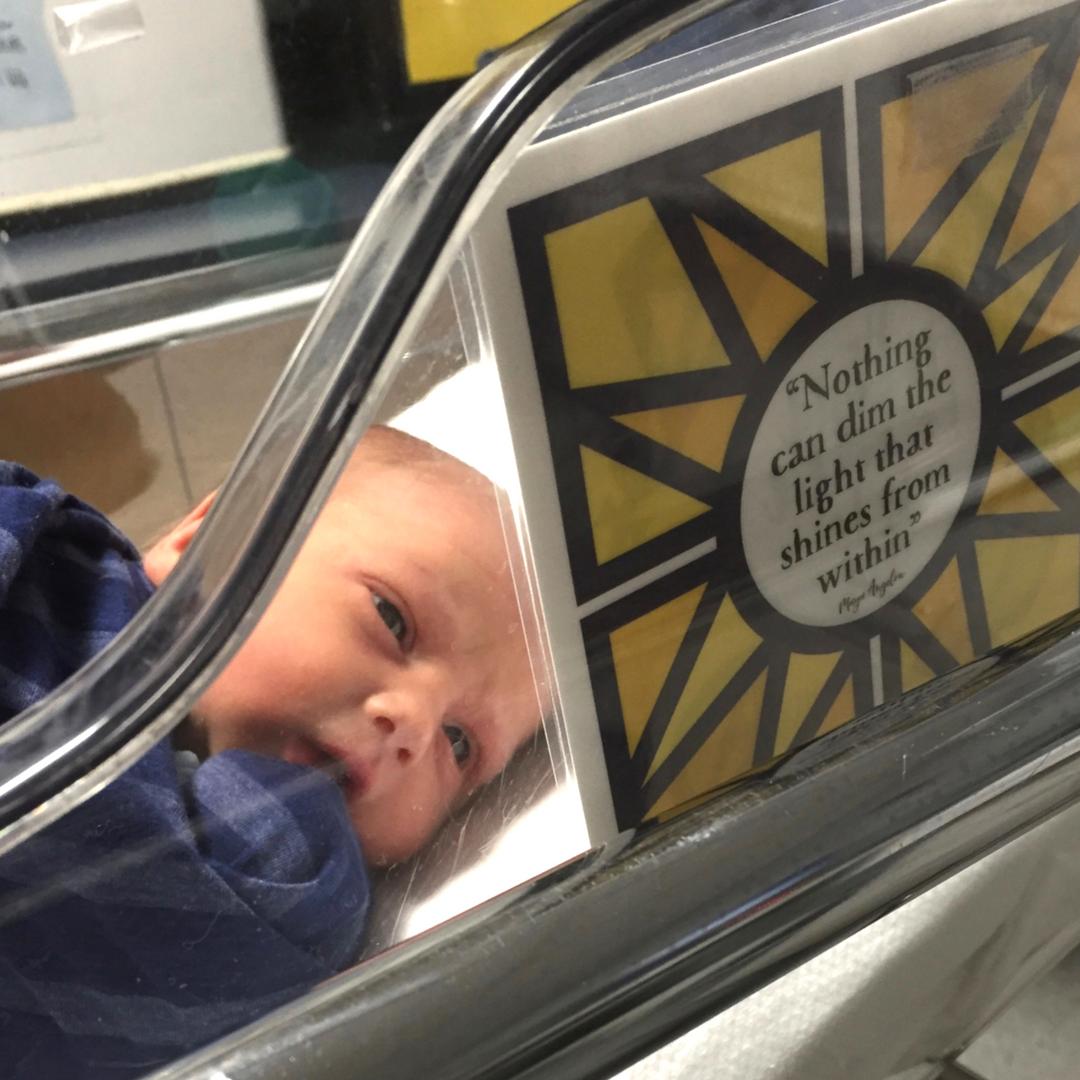 baby in hospital crib looking at NICU Crib Art