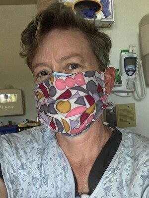 cloth mask over surgical mask in NICU