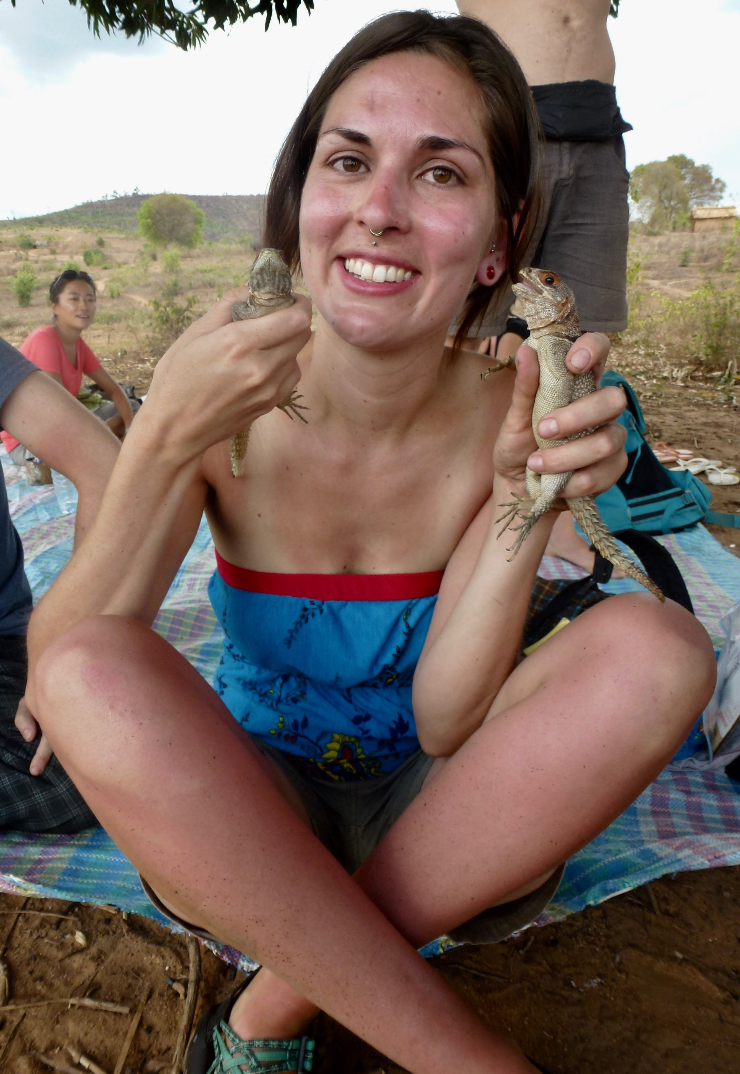 Here I am with the worst sunburn of my life and two iguanas.