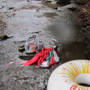 Remains of supplies and supply tube after a particularly frisky section of rapids on the East Branch.