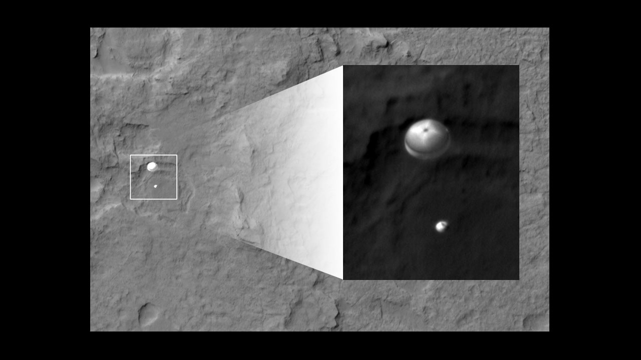 Mars Reconnaissance Orbiter took one of my favorite space images: MSL slowing down under its parachute. Credit: NASA/JPL-Caltech/Univ. of Arizona