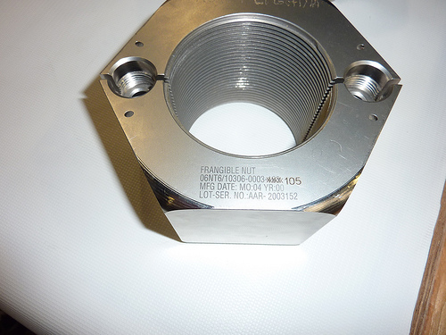 A version of the SRB frangible nut with rounded-over corners. This model was never used on a launch.