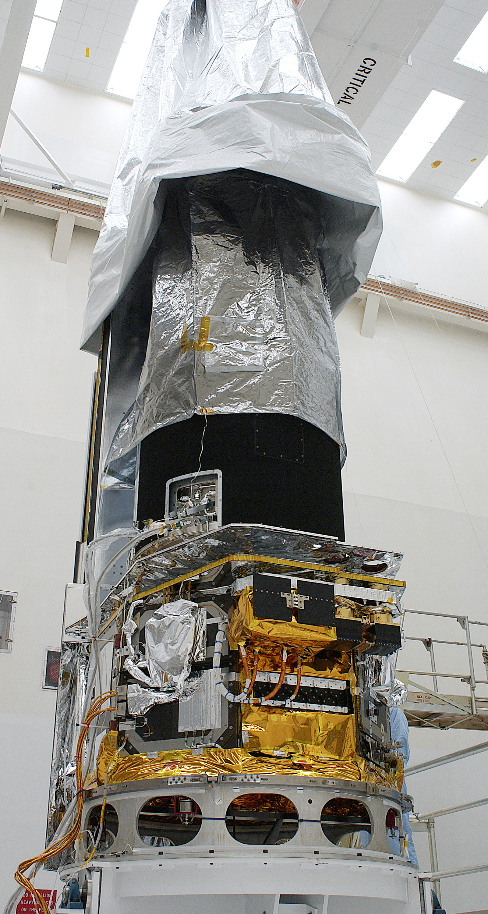 Spitzer and its dust cover
