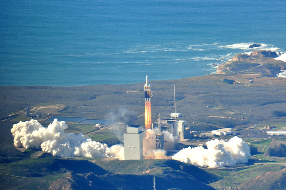 A Delta IV Heavy lifts off from Vandenberg