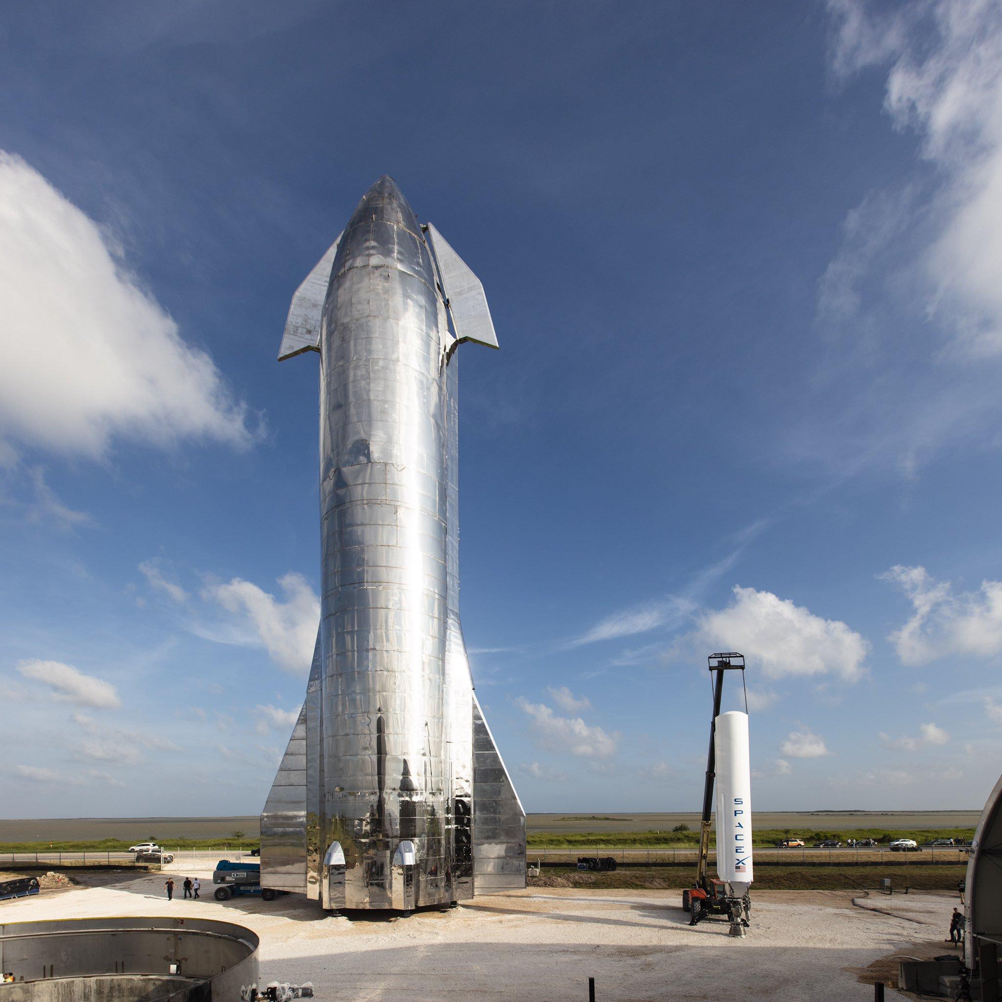 Starship next to Falcon 1
