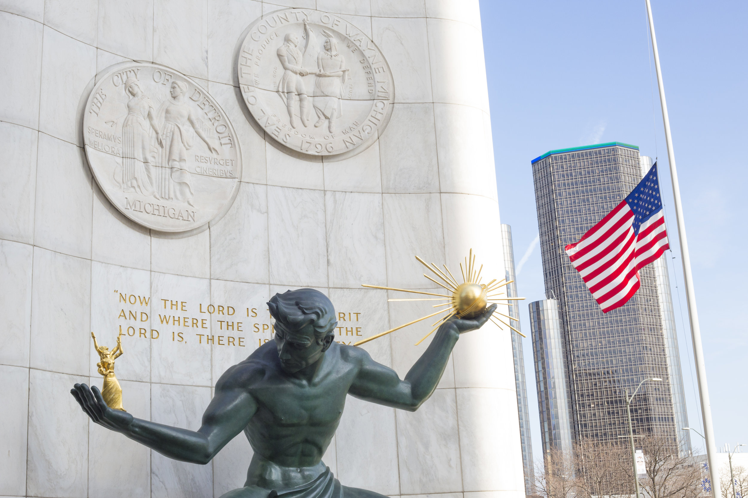 The Spirit of Detroit represents the strength of the city. In the left hand, the statue holds a symbol of God and in the right, one of the family. During major sporting events, residents dress the statue in the corresponding home team colors.