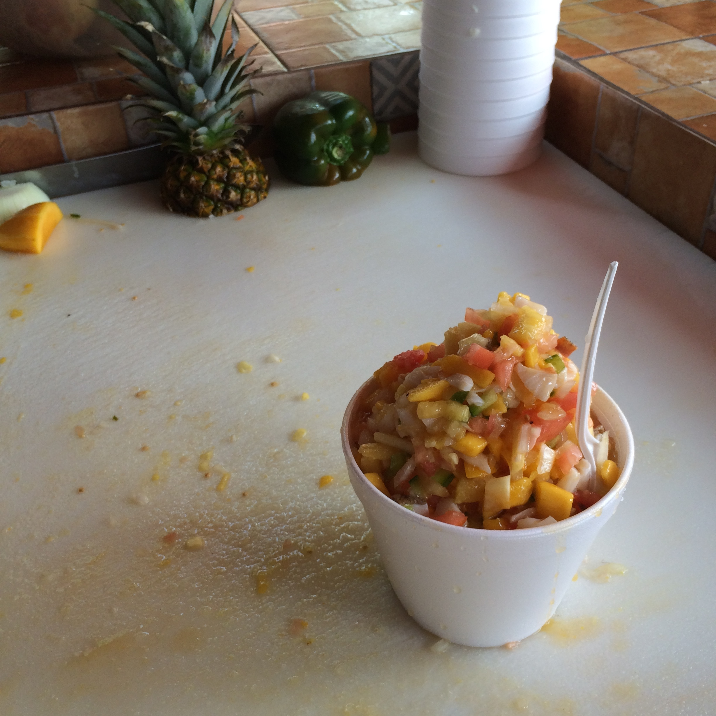 Tropical scorched conch salad with tomatoes, mango, and onions prepared at the Arawak Cay locally known as the Fish Fry.