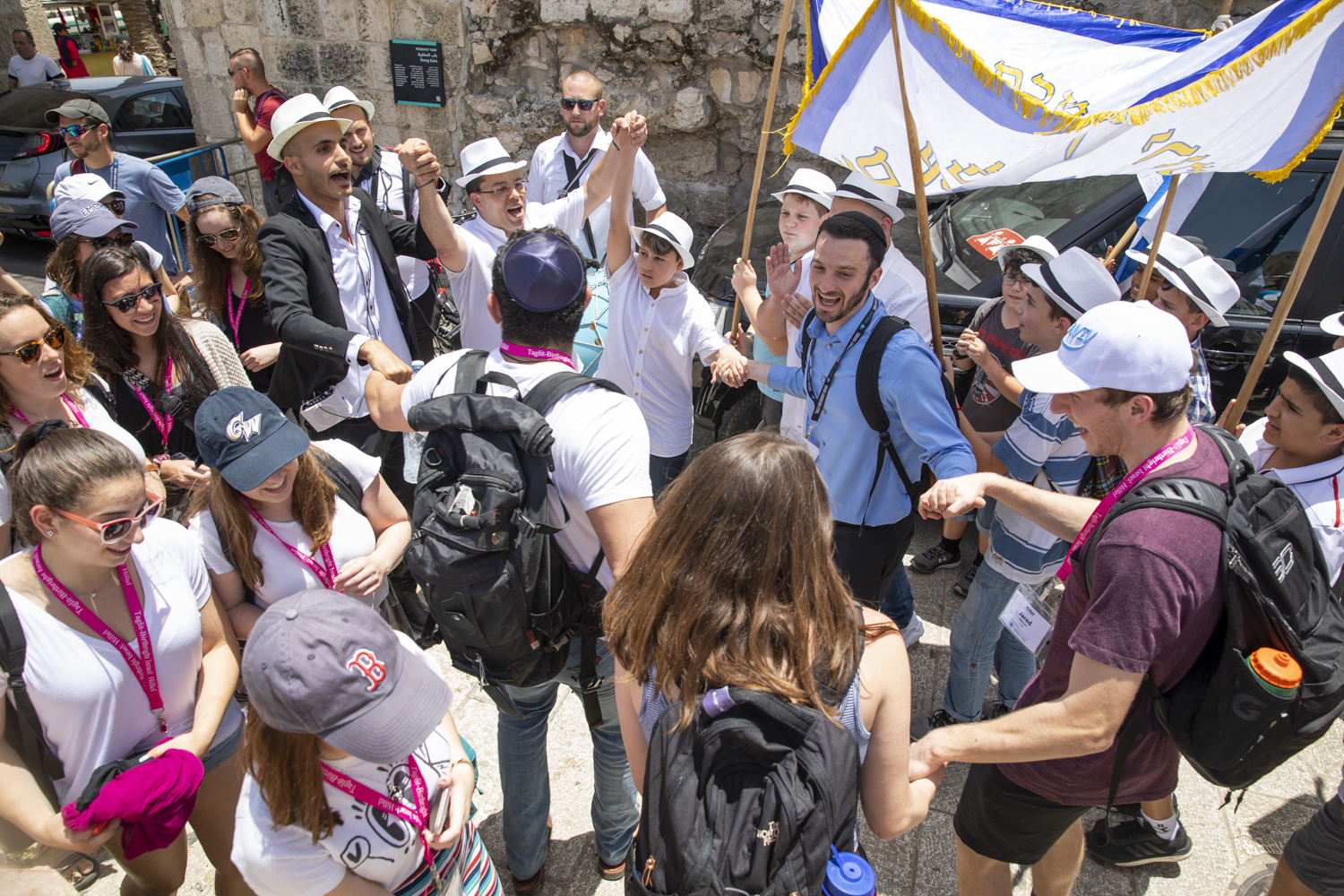 """Numerous Bar Mitzvah celebrations paraded through the area outside the Western Wall. These are common throughout Jerusalem each Thursday when most families host their sons' Bar Mitzvahs in """"The Holy City""""."""