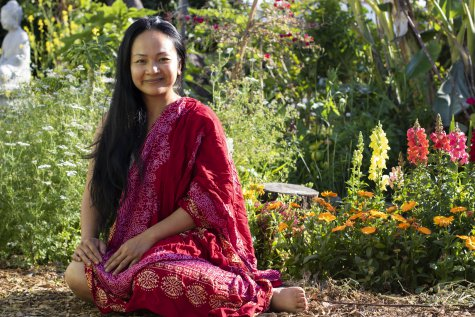Laura Som, survivor of the Cambodian genocide and founder of the MAYE Center, sits in the community garden surrounding the MAYE Center on East Anaheim Streura Som, sur