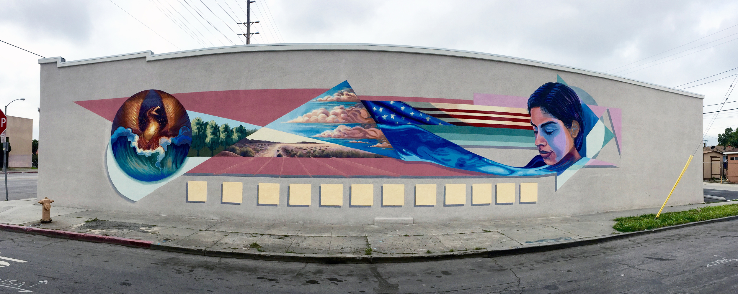 """""""Wanderer, there is no road, the road is made by walking""""  This mural project is sponsored by the City of Long Beach Office of 9th District Councilman Rex Richardson. It is part of the Creative Corridor Mural project series titled Uptown Renaissance. It is painted on the Intercity Fellowship Hall building"""