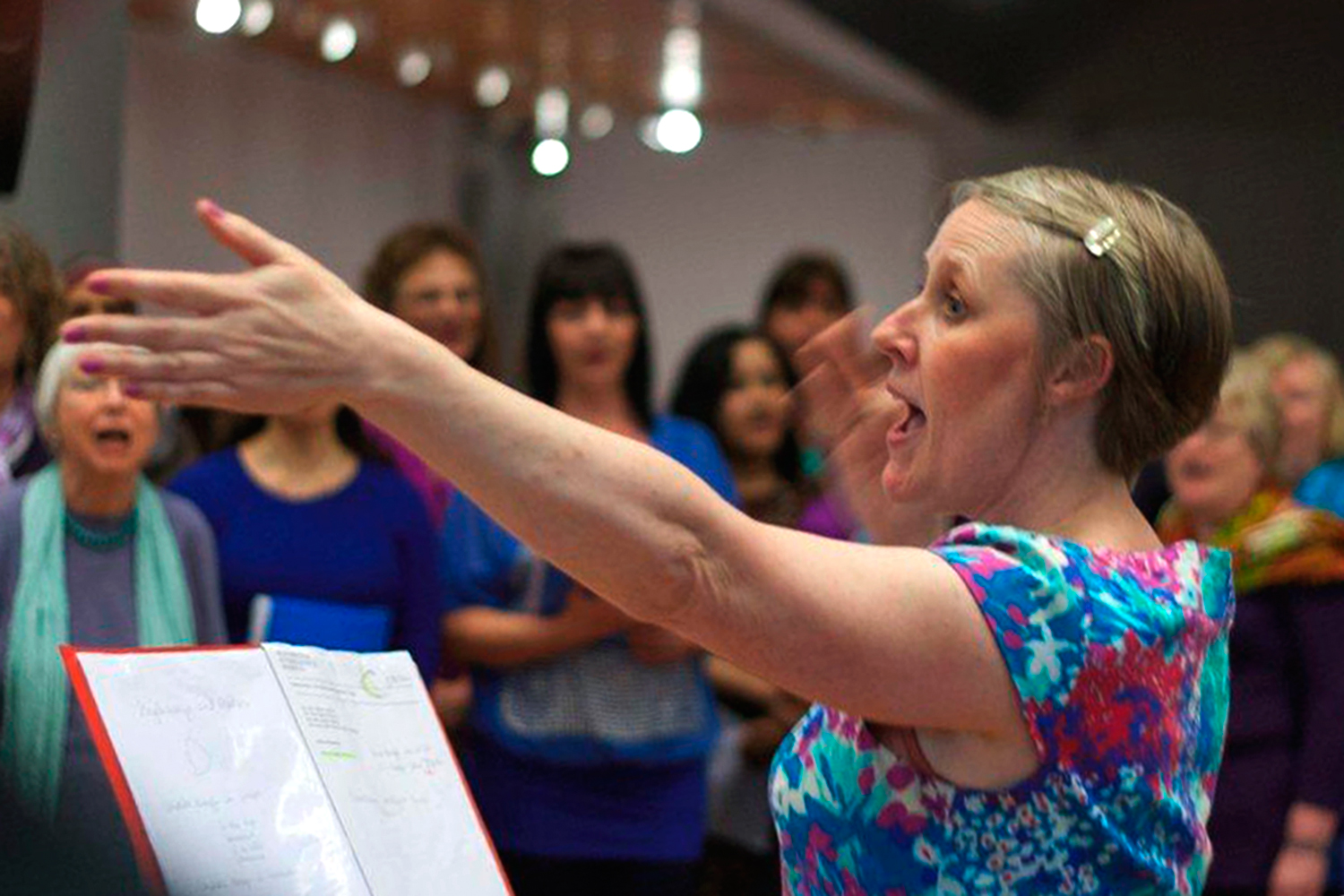 Beth Allen leading the choir through the performance at the MIF13 Volunteers launch event Photo: Robert Martin for Manchester International Festival