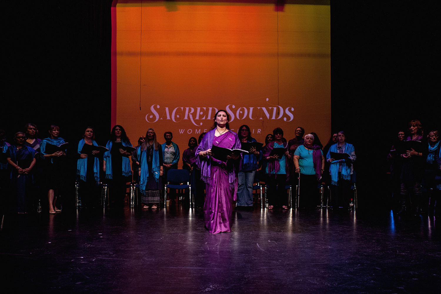 A choir member leading the rest of the Sacred Sounds Women's Choir in the Buddhist Peace Chant 'Shaantih' Photo: Michela De Rossi