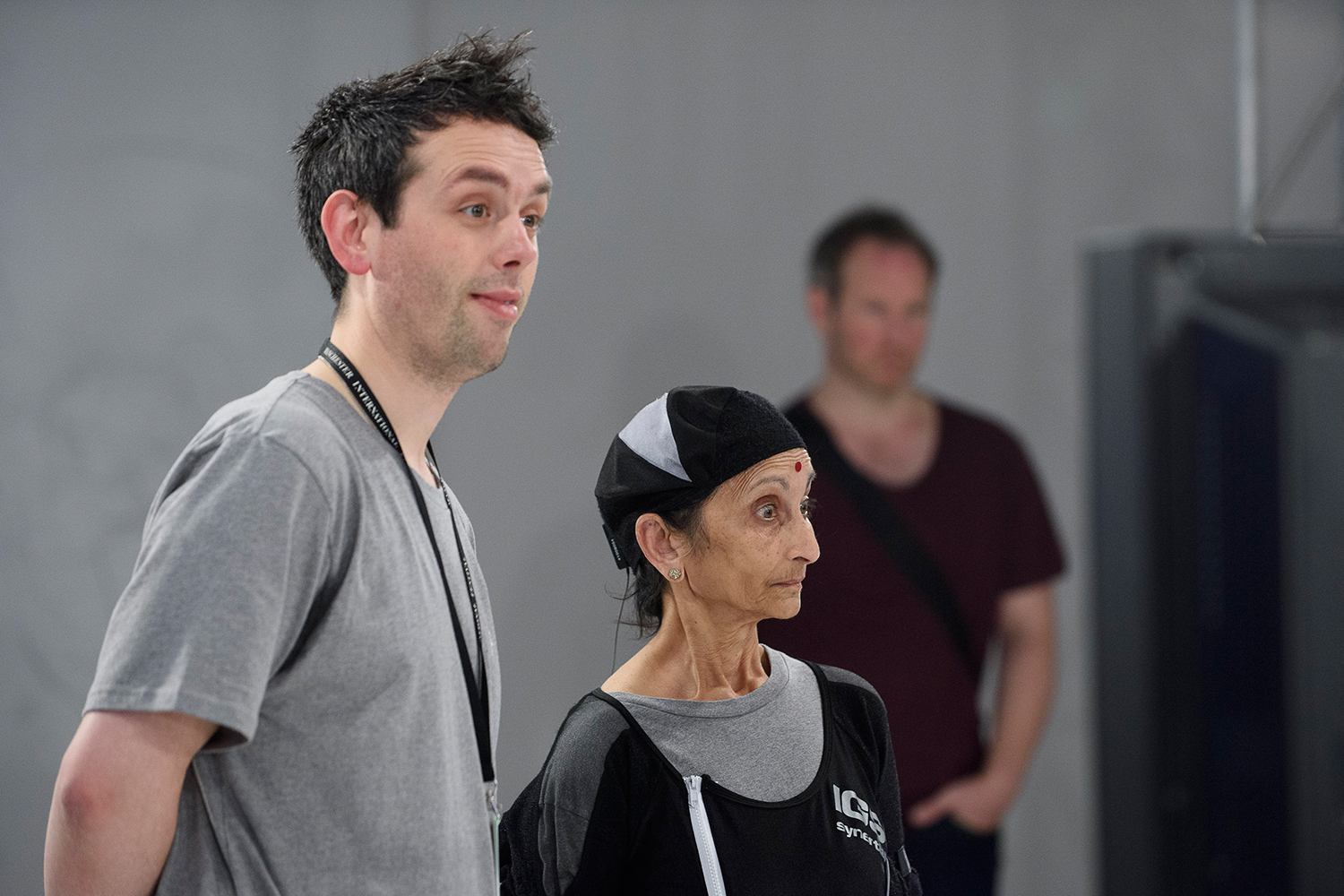 Sacred Sounds Women's Choir member Asha with Ed Atkins, taking part in 'Performance Capture' at Manchester Art Gallery for MIF15 Photo: Joel Chester Fildes for Manchester International Festival