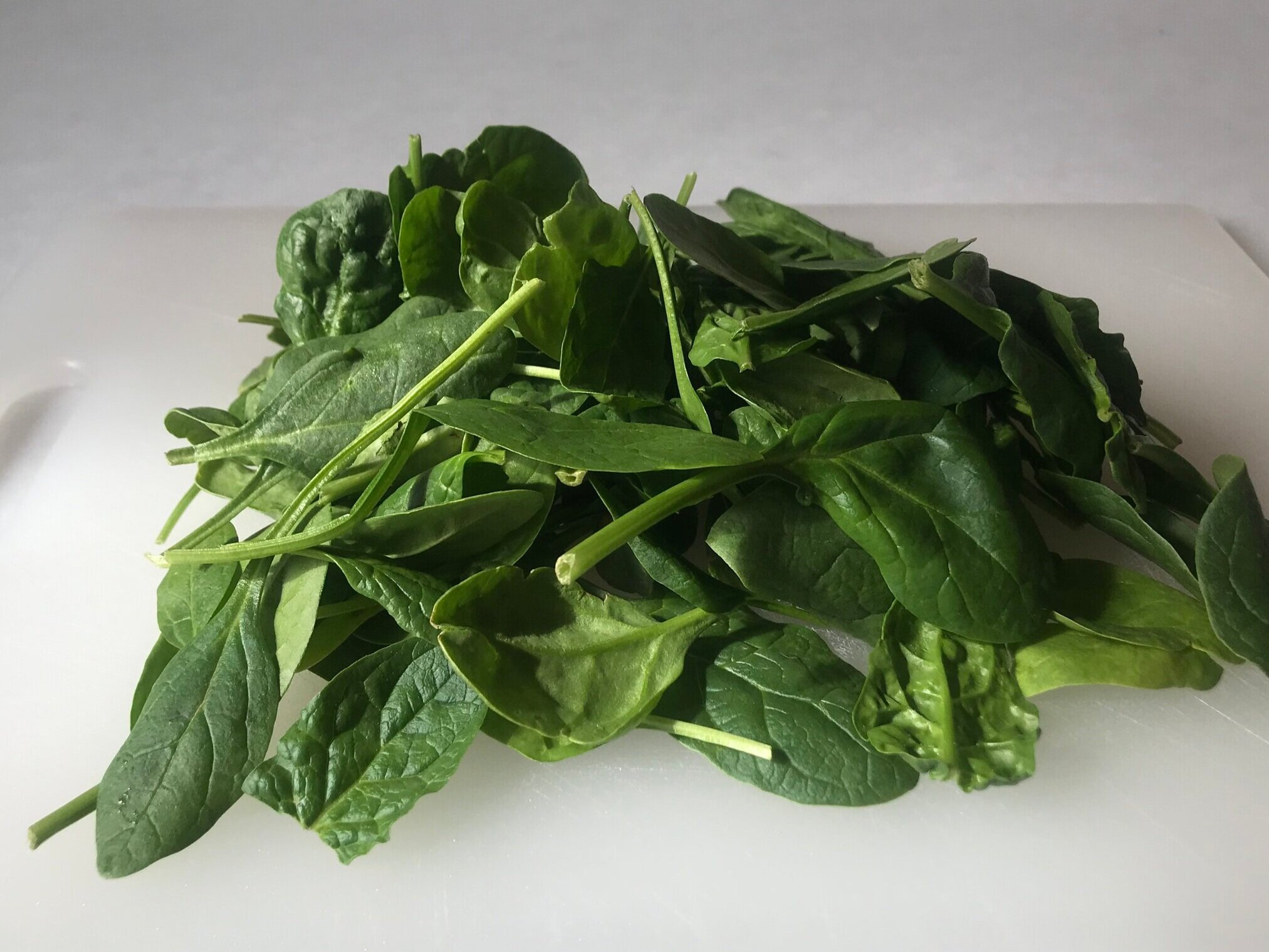 A handful of spinach adds color and vitamins to your aush dish