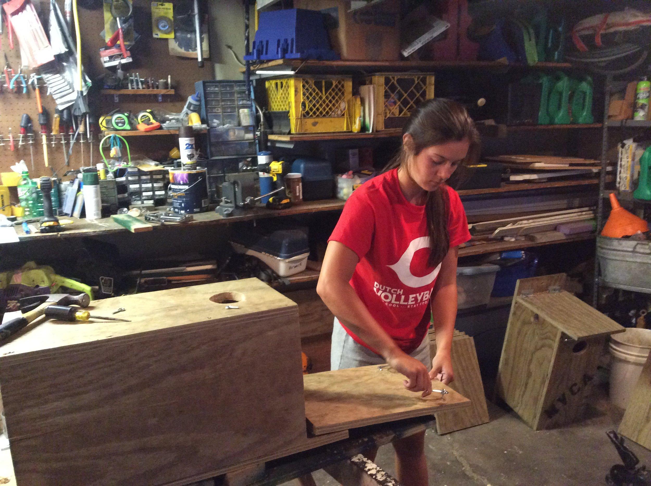 Sarah making wood duck boxes 8-2015 (12).JPG