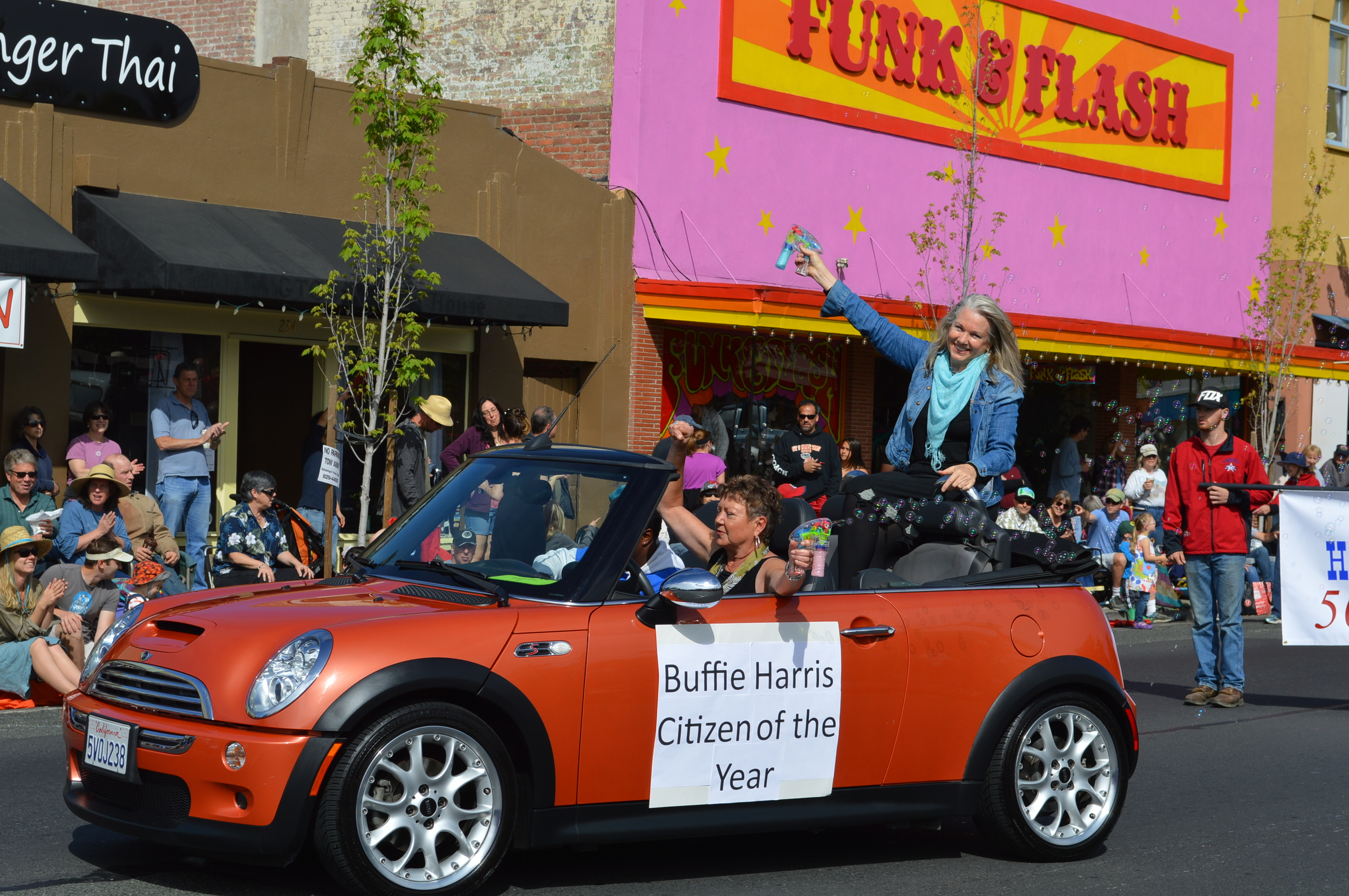 """Photo by David AbbotT, Sonoma West coverage of the 2015 APPLE BLOSSOM PARADE.  """"This year's Grand Marshal was Buffie Harris Francisco — proprietor of Design Orbit, a Sebastopol-based graphics company — trailing bubbles and resplendent in the moment."""""""