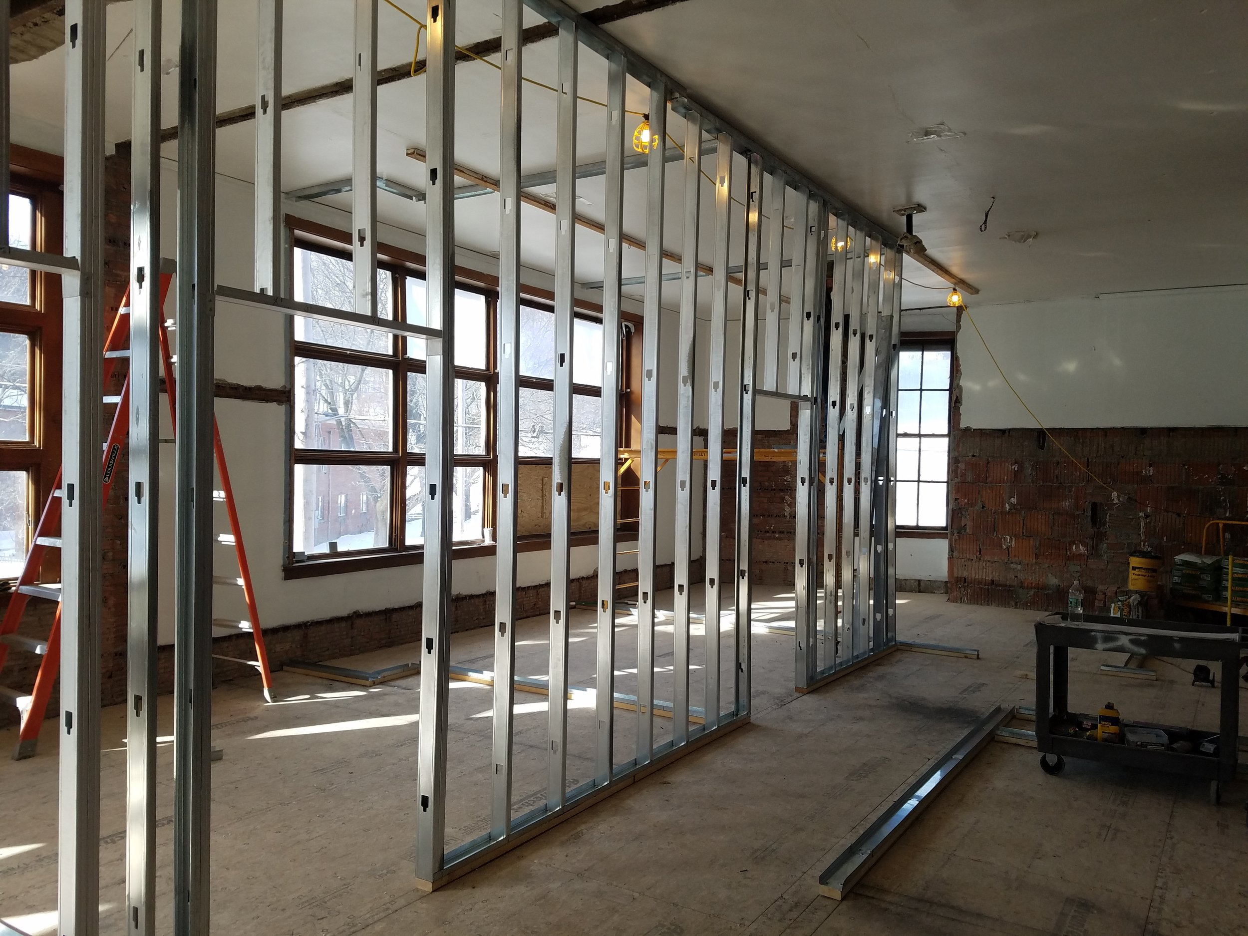 Framing for walls on first floor in progress.