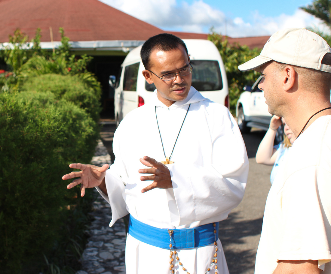 Fr. Dionisio, giving a tour of Mt. Tabor monastery to a group of volunteers.