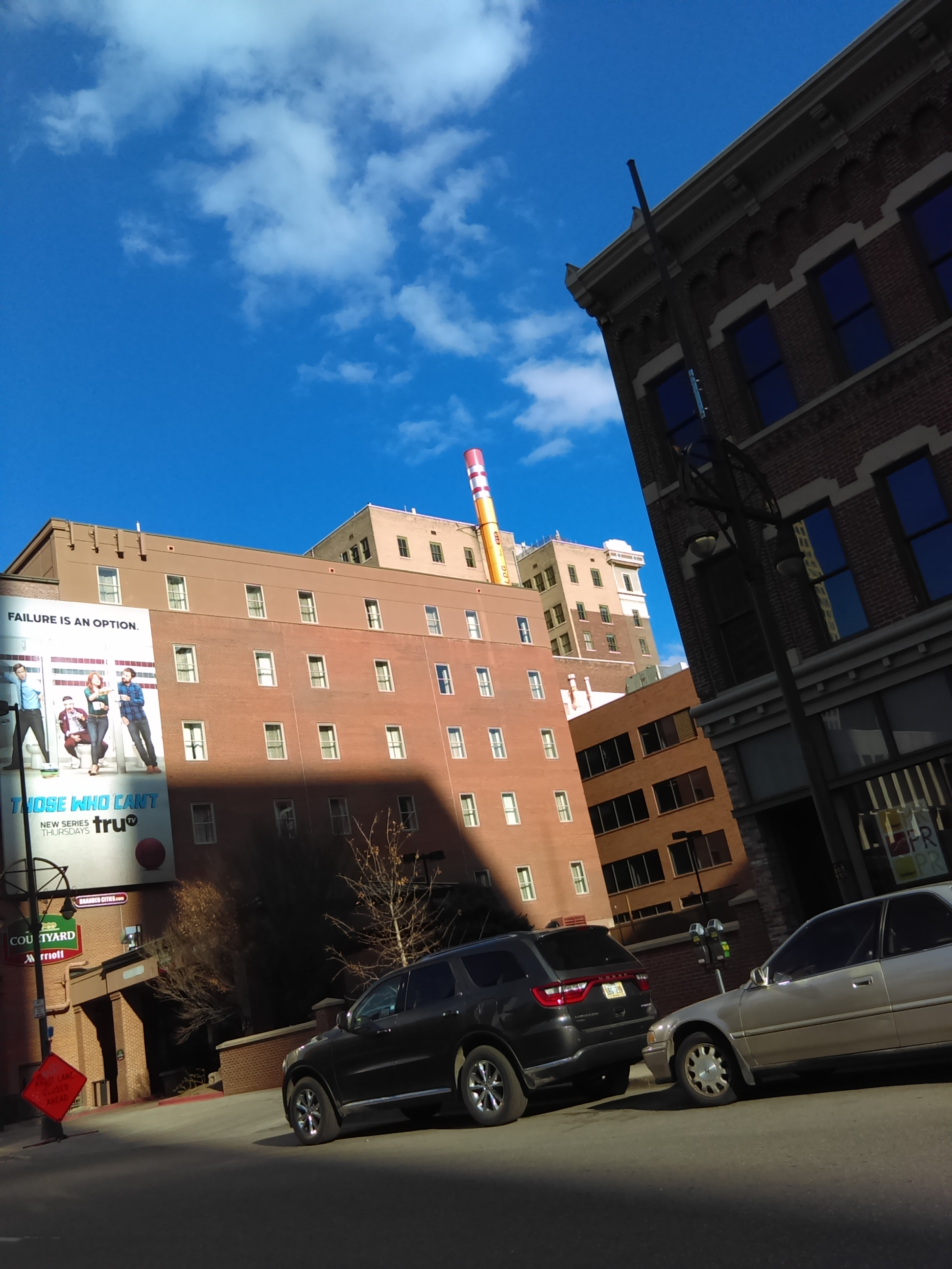 There is a building in Downtown Denver with a pencil for a smoke stack…