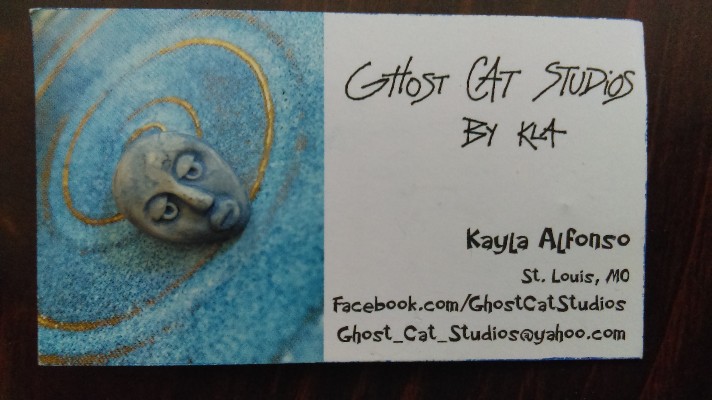 A little face pin by Kayla Alfonso of  Ghost Cat Studios .
