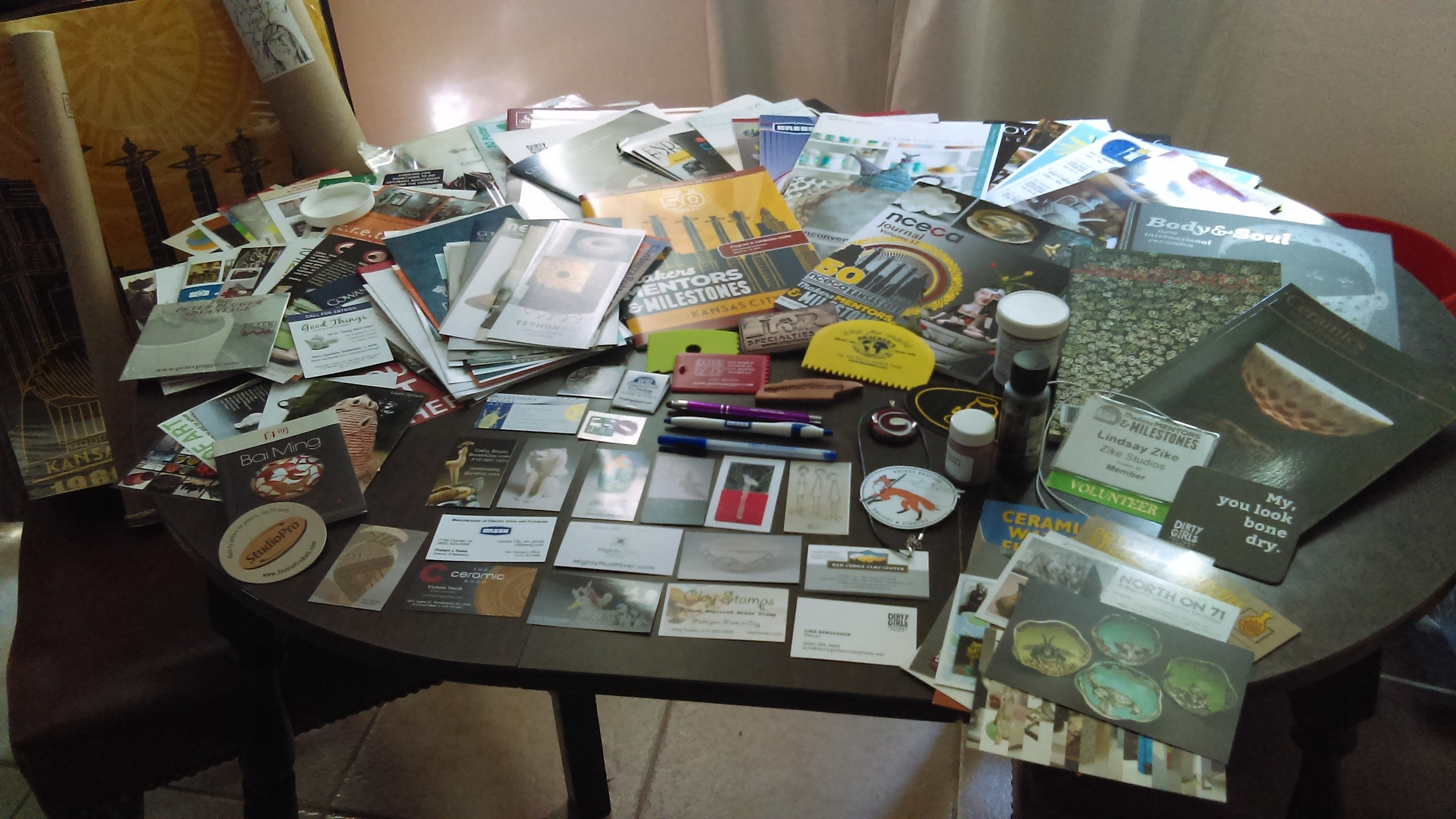 Swag from the Resources Floor. Mostly fliers and brochures, but also some samples, posters, pens and ribs.