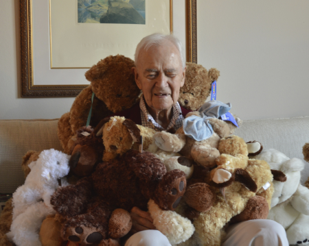 """Dad at his 100th Birthday party in December, 2014. Teddy Bears were donated to the Huntington Beach Police Department for officers to give to neglected and abused children who are put into protective custody. The program is now known as """"Bruce's Bears."""""""